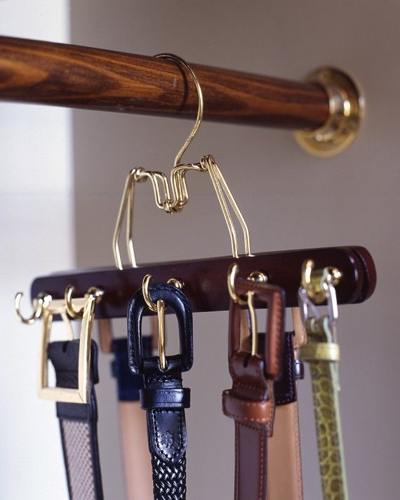To create a belt rack that matches your other hangers (and doesn't require making holds in the wall), try this: Predrill a row of holes in alternating spots on both sides of a wooden clamp hanger, and screw in cup hooks. Make as many of these hangers as you need to accommodate your belts.