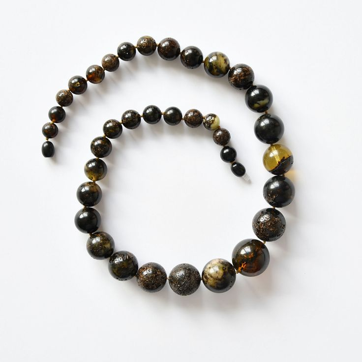 """SIZE: 50 cm WEIGHT: 47 g. DESCRIPTION: Very beautiful amber beads of perfectly round amber balls. Some of them look like perfect black pearls. Thus, we can bravely call these beads - """"Black pearls""""."""