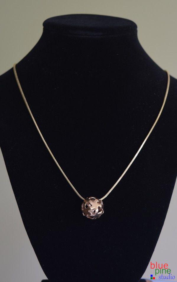 Pendant necklace in precious and semi-precious metals, a design by Blue Pine Studio