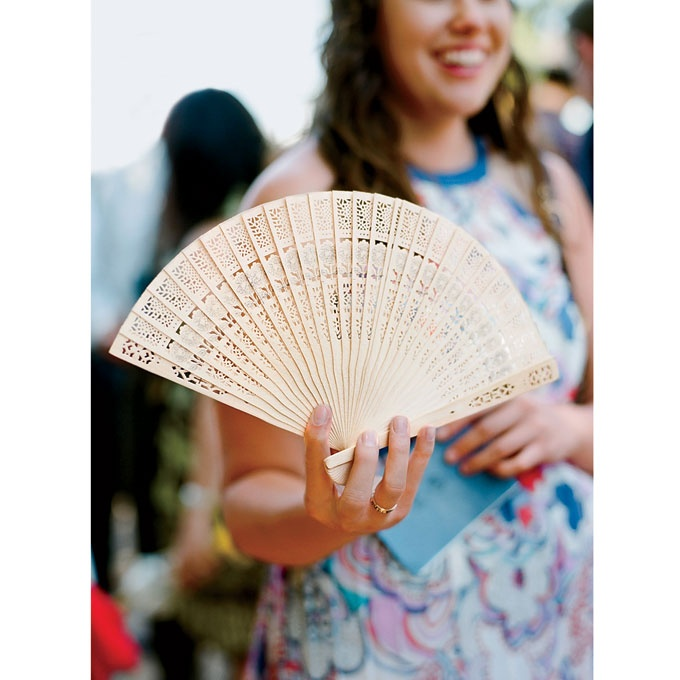 Wooden fan wedding favor. Photo: Lisa Lefkowitz.