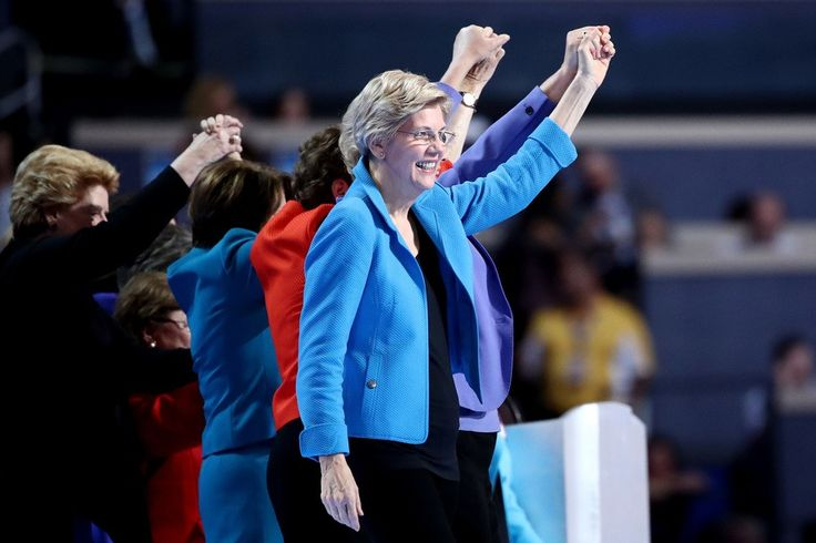 PHILADELPHIA, PA - JULY 28:  Sen. Elizabeth Warren (D-MA) along with members of the Democratic Women of the Senate acknowledge the crowd on the fourth day of the Democratic National Convention at the Wells Fargo Center, July 28, 2016 in Philadelphia, Pennsylvania. Democratic presidential candidate Hillary Clinton received the number of votes needed to secure the party's nomination. An estimated 50,000 people are expected in Philadelphia, including hundreds of protesters and members of the…