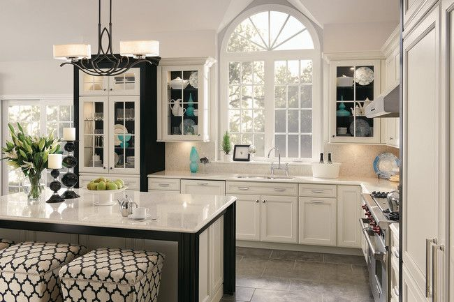 Interior Kraftmaid White Cabinets glass doors with contrasting back panels create a dramatic backdrop for putting favorite serving pieces on distinctive display pinter
