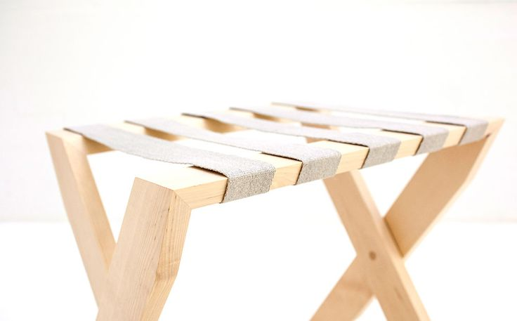 Hover X is a luggage rack created by two interlocking rectangular wood elements, which have strips of linen stretched between them. The design aims at effortless elegance, and high degree of functionality.