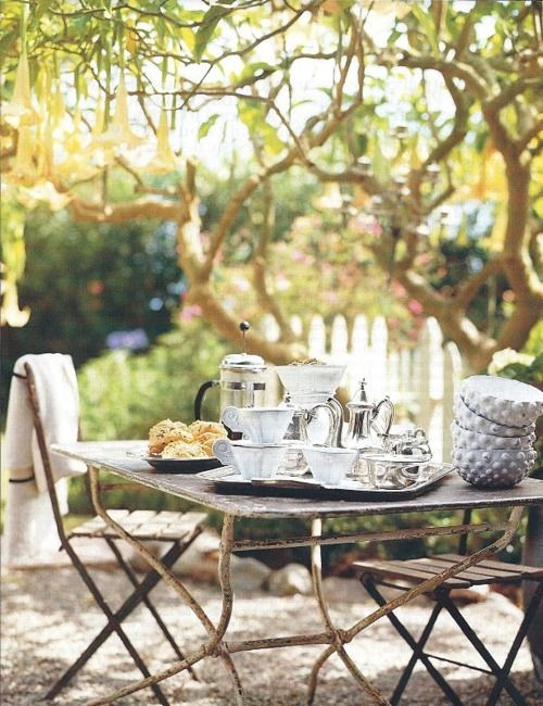 Love the rustic metal table for the backyard!