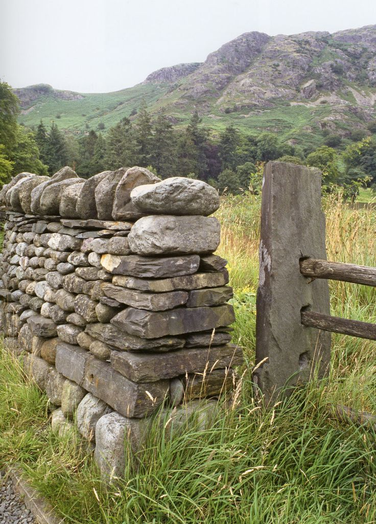 stone fence post and freestanding field stone wall