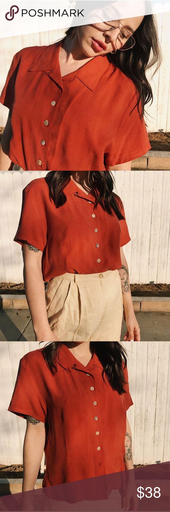100% Silk Vintage Burnt Orange Short Sleeve Top 100% Silk Vintage Burnt Orange Short Sleeve Top. Beautiful condition, beautiful buttons Vintage Tops Button Down Shirts