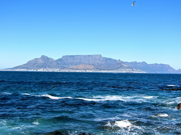 Cape Town and Table Mountain from a distance. Picture taken from the shores of Robben Island, South Africa.