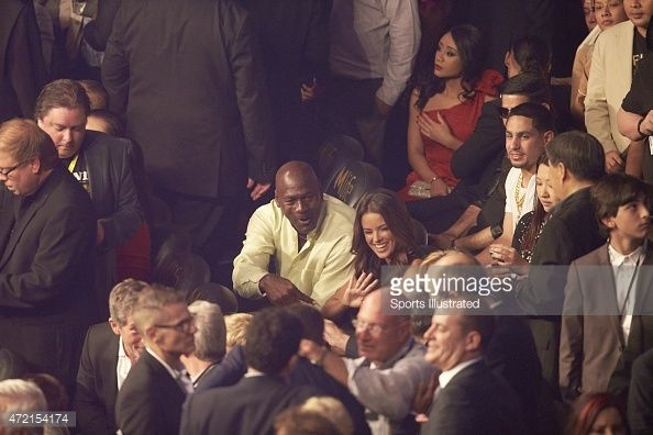 WBA Super World / WBC / WBO Welterweight Title: Charlotte Hornets owner Michael Jordan and wife Yvette Prieto in crowd before Floyd Mayweather vs Manny Pacquiao fight at MGM Grand Garden Arena. Las Vegas, NV 5/2/2015 Simon Bruty X159560 TK1 )