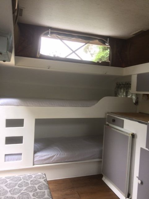 Millard Pop Top 15 Foot Caravan. New curtains on all windows and privacy curtain for double bed. No money to spend – just enjoy! Sleeps 4 (plus more room in the annex). Storage under beds, front and rear. | eBay!