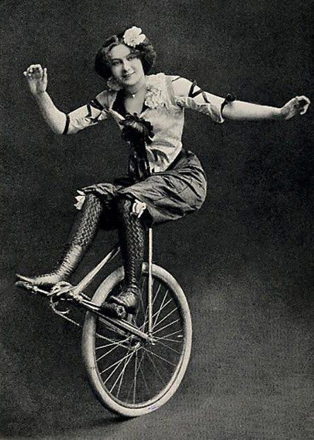 A one-wheeler, rather. But still a lady. And her bicycle.  Hoopla!