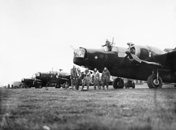 ROYAL AIR FORCE BOMBER COMMAND, 1939-1941. Aircrew and Wellington bombers of No. 149 Squadron RAF at Mildenhall, Suffolk, before a night raid over Germany, 10 May 1941