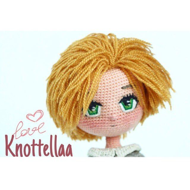 Amigurumi doll with green eyes. Cute! ❤️