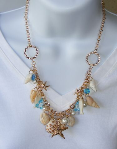 Shell necklace earring set,with star fish pendant and sea charms.