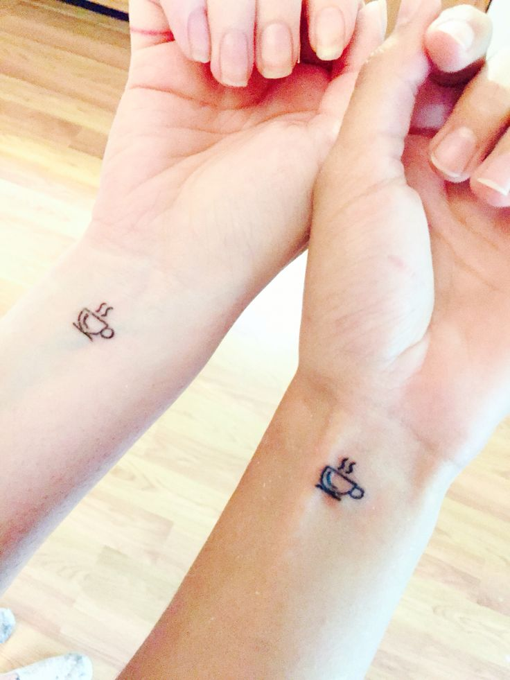 Matching coffee cup tattoos for two baristas who love their jobs