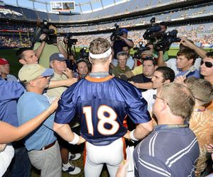 Are you ready for Preseason Bears Football tonight?    August 4, 2012; Englewood, CO, USA; Denver Broncos quarterback Peyton Manning (18) talks to the media following training camp drills at Sports Authority Field. Mandatory Credit: Ron Chenoy-US PRESSWIRE
