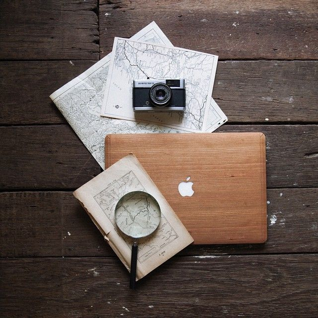 Taking time to think about all the endless places I need to explore – maps + film cameras + thanks to @glitty_ for my wonderful handmade cherry-wood cover for my MacBook. I always love anything made by hand from natural materials so this is pretty perfect for me. #glitty