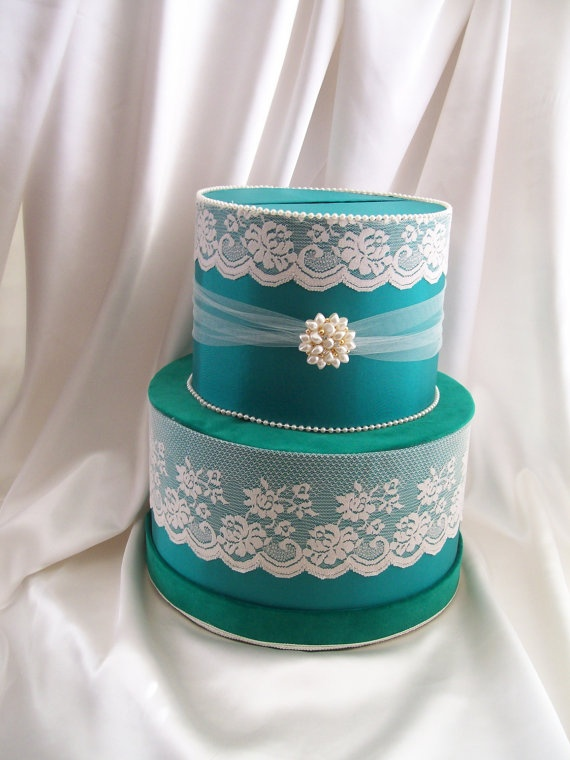 Hat boxes for card box just put your color on them. Pretty blue with pretty lace :)