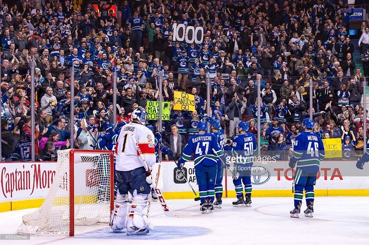 Vancouver Canucks Center Henrik Sedin (33) is congratulated by the Canucks after scoring a goal and his 1000 point on Florida Panthers Goalie Roberto Luongo (1) during their NHL game at Rogers Arena on January 20, 2017 in Vancouver, Canada.