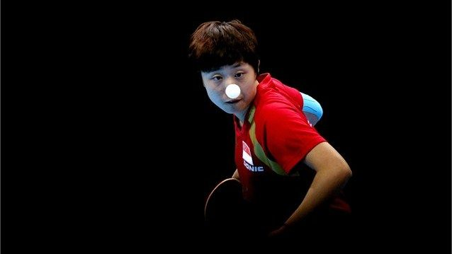 Feng Tianwei of Singapore competes against Kim Kyung Ah of the Republic of Korea during the women's Team Table Tennis bronze medal match on Day 11.