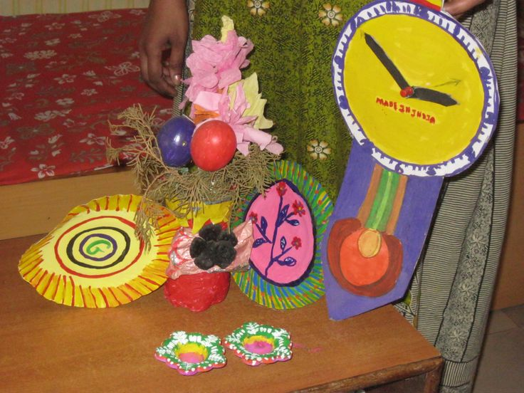 All my creations. Rs. 110 for the clock, Best out of Waste flower-vase with flowers Rs. 100, a pair of diyas Rs. 100 each