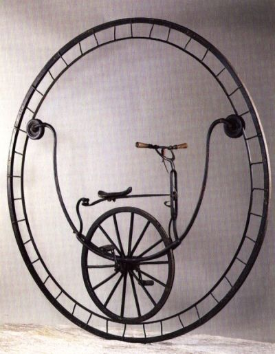 """In 1869 the craftsman Rousseau of Marseilles built this monocycle, which perches the cyclist on the inside of a 2 1/2 yards-high wheel. As there is no steering mechanism, it makes uncommon demands on the rider's sense of balance."" (from Galbiati & Ciravegna)"