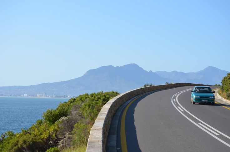 Strand Beach Road apartment blocks visible across False Bay from Clarence Drive (between Gordons bay and Rooi-Els). Helderberg mountain behind Strand. #strand #Strand #Strandbeach #beachroad #clarencedrive #gordonsbay #rooiels #helderberg