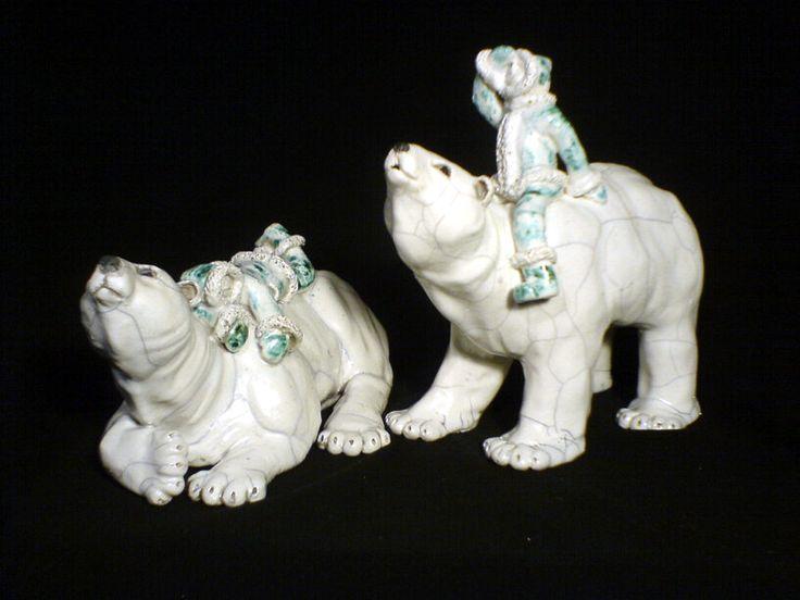 Raku sculptures - polar bears with their eskimo riders