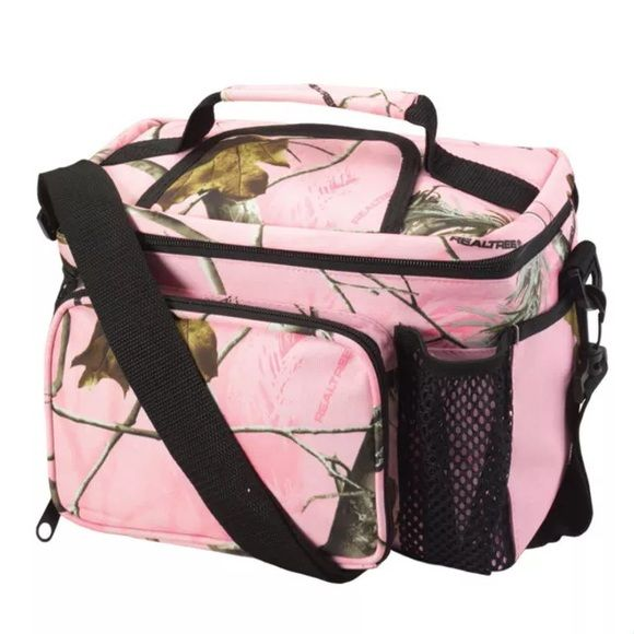 "Kati- Lunch Cooler Bag KATI PINK CAMO LUNCH COOLER BAG 600D polyester with PVC backing  • Insulated waterproof lining  • Adjustable removable shoulder strap  • 11""W x 9""H x 7""D, 11.3L • Front zippered pocket  • Two outside mesh pockets • End outside pocket • Easy access Velcro® top flap • Holds up to 12 beverage cans Kati Bags Travel Bags"