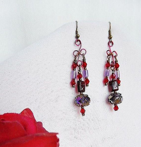 #elegancebydorianne #victorianstyle #victorianjewelry #victorianearrings #gothicstyle #gothicearrings #VictorianGothic #etsyjewelryshopowner #etsyjewelry #etsyseller #giftforher  Vibrant, Romantic, Victorian Chandelier Earrings in red and purple with a Gothic ambiance! Deep rich burgundy enameled wire earring frames