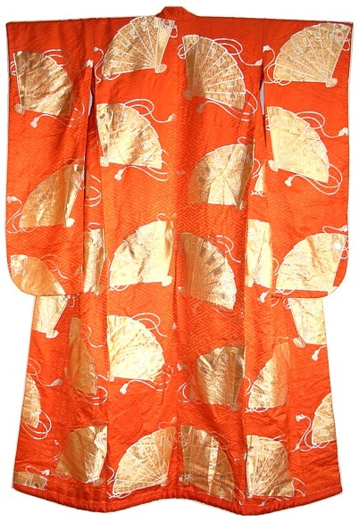 Japanese traditional silk brocaded wedding kimono gown, uchikake, 1950's. Golden Japanese folding fans and silk ropes on orange red silk brocade patterned background.  Material: silk