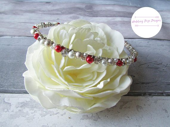 Check out this item in my Etsy shop https://www.etsy.com/uk/listing/529569407/red-wedding-hairband-bridal-headband