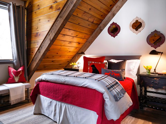 Perfect red accents in this western, rustic cabin bedroom.