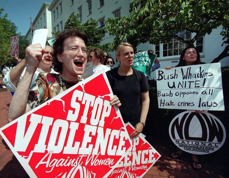 Kim Gandy (L), from Louisiana, along with other members of tha National Oragnization of Women (NOW) and other feminist groups shout slogans while demonstrating 25 August, 2000 in front of the Republican Party headquarters in Washington, DC. NOW is protesting US presidential candidate George W. Bush's record on women's rights.