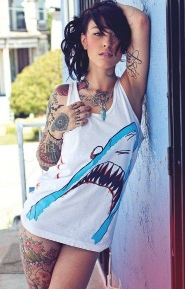 Suicide girl with tattoo sleeve