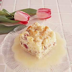 Rhubarb Pudding Cake Recipe from Taste of Home topped with sugar and vanilla sauce