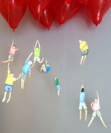Hanging people on the end of helium balloons. Fun. Make your own by hand or out of photos of the kids (posed especially for this and/or the bookmarks idea elsewhere on this inboard). You could also use favorite things, animals, cartoon characters, etc....(via @WallCandyArts)