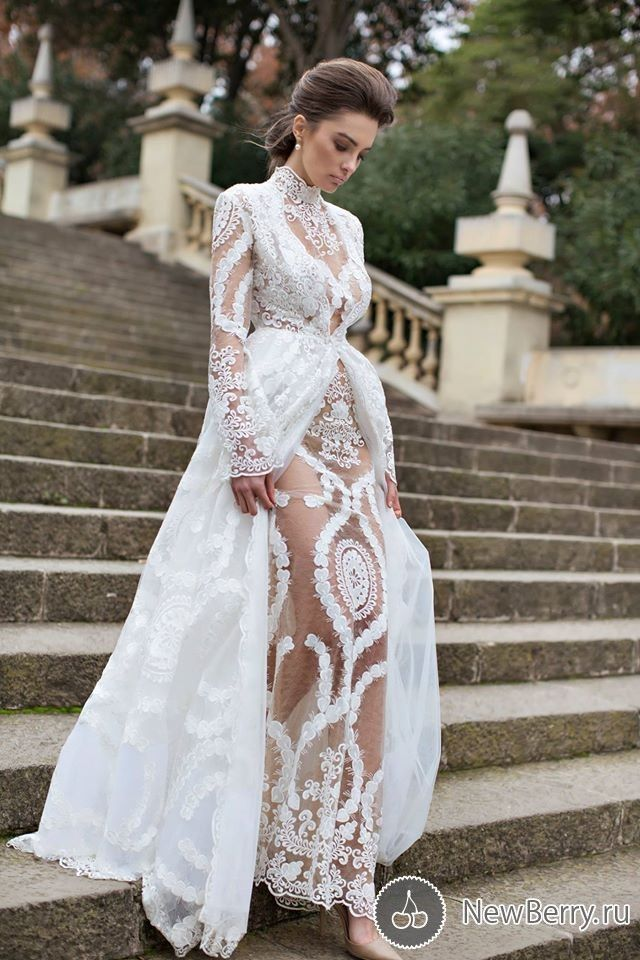 Stunning Sheer White Long Sleeved beaded gown for Dimitrius Dalia.