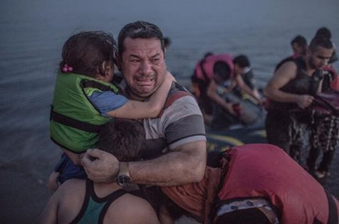 Joe Brennan When you next ponder posting a 'funny' piss off we're full picture or a Britains First post about migrants being scum, parasites, swarm of thieves etc. look at this father with his child escaping from Syria and imagine looking him in the eye and pushing his boat back out to sea...