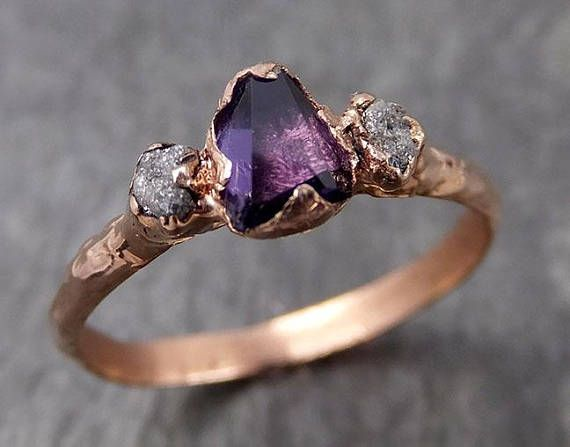 Partially faceted (by my husband) ultraviolet sapphire with raw conflict-free diamonds on each side. I hand carved this ring in wax and cast it in recycled solid 14k rose gold using the lost wax casting process. This one of a kind raw gemstone ring is a size 8 3/4 it can be resized. The