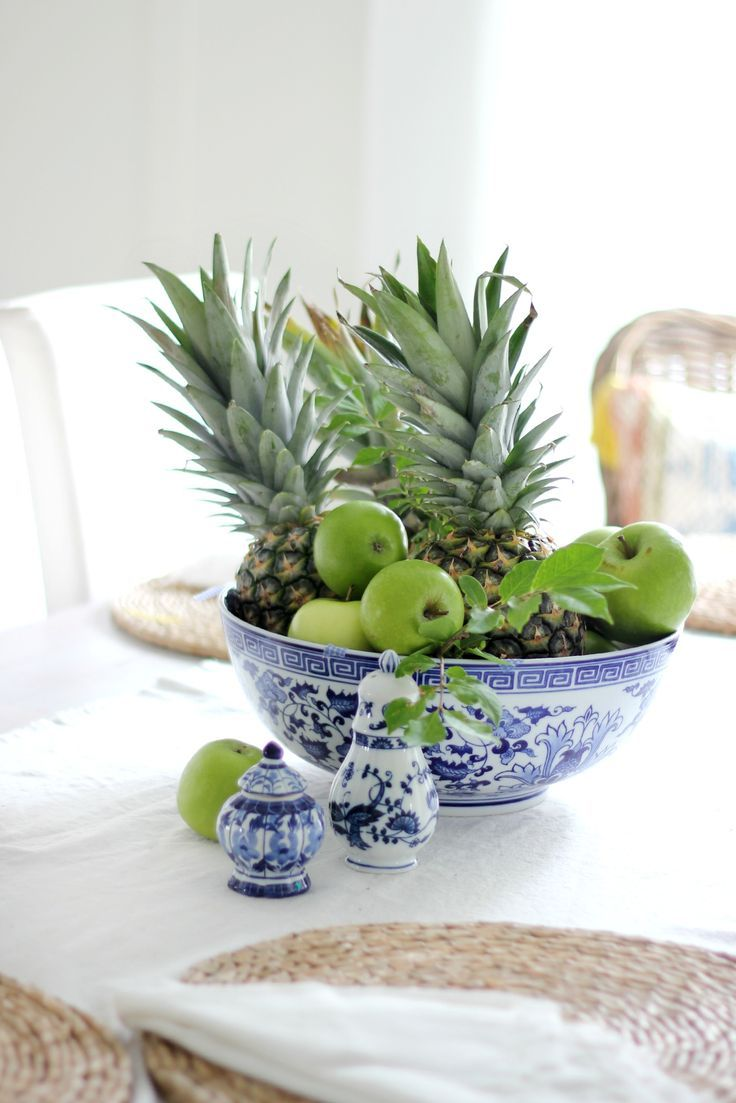 Beautiful blue bowl with green fruit perfect for spring kitchen