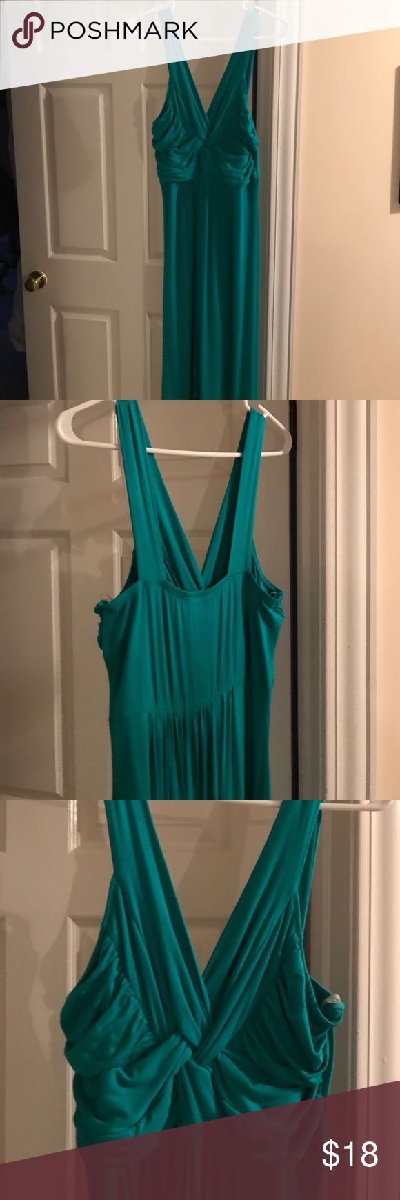 """Bright teal maxi dress. Teal cotton blend maxi dress. Beautiful criss cross/ruched top with long skirt.  From shoulder to bottom hem is 58.5"""". Perfect condition. It's long on me and I'm 5'8"""". I can wear heels with it. Charming Charlie Dresses Maxi"""