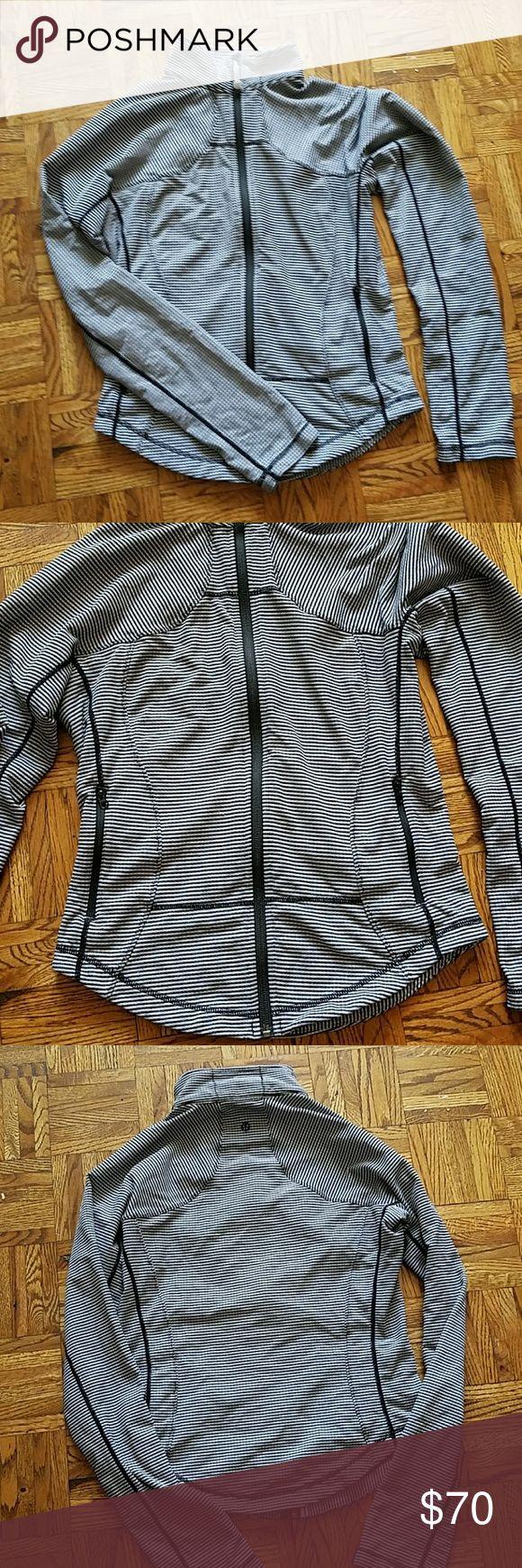 Lululemon black and white jacket Striped almonst hounds tooth pattern lululemon jacket. Zips up the neck. Side pockets. Perfect condition. Size 8 lululemon athletica Jackets & Coats