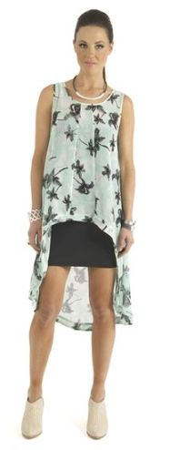Pam tree Mint Mullet Tunic worn over a simple black dress.