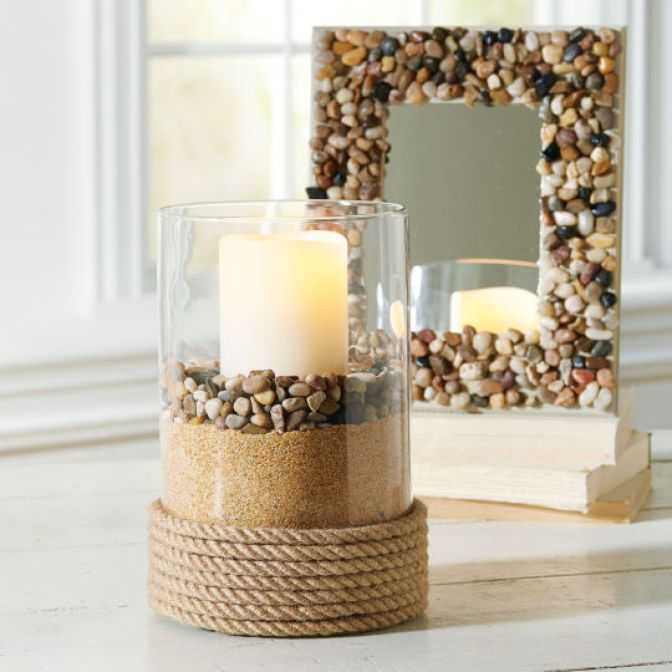 DIY River Rock Mirror with candle in clear hurricane in