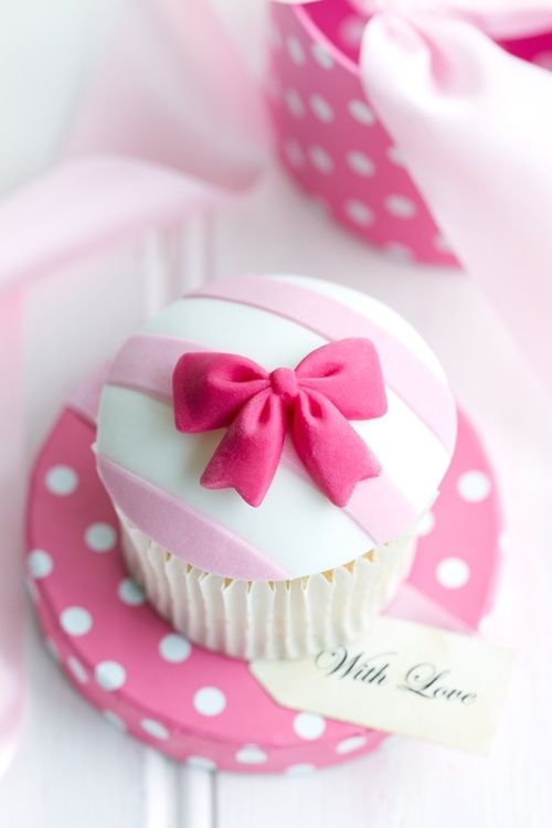Pink Bow Cupcake toppers. Light pink horizontal stripes with hot pink bow. Perfect for a little girl's first birthday.