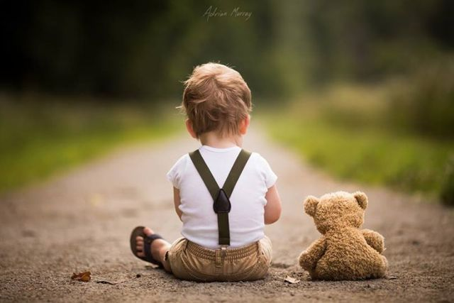Little boys in suspenders, tan pants, maybe a simple white top. Neutral colors, vintage style.
