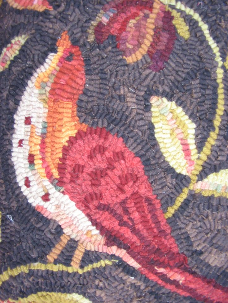 Some of the completed rug designs offered by Wool Junction.
