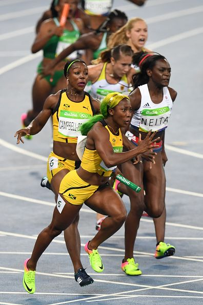 Jamaica's ShellyAnn FraserPryce competes in the Women's 4x100m Relay Final…