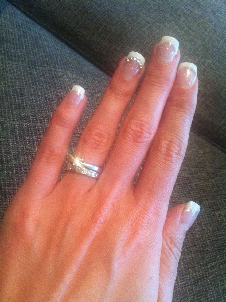 Pretty sparkly nails with swarovski crystals on the ring fingers
