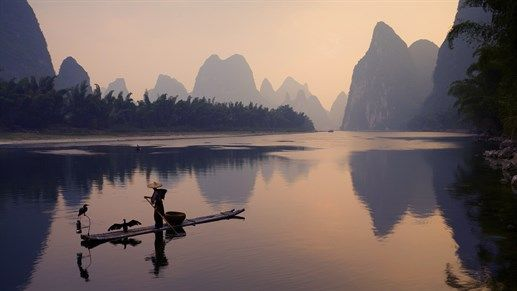 True tranquility. Reflections in the waters of Li River in China #asia #kilroy #backpacking #landscape #water #boat #china